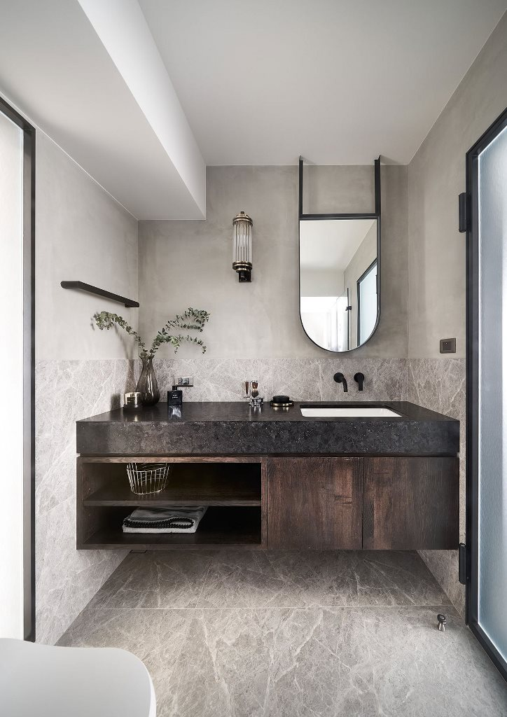 There's a floating vanity with a black countertop and some greenery