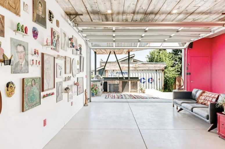 This living room is very bold with its half done in pink, a bold gallery wall and an access to the outdoor kitchen