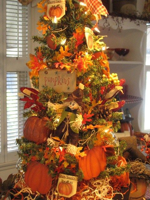 a creative vintage-inspired Thanksgiving tree with lights, faux leaves, pumpkins, signs, paper pumpkins