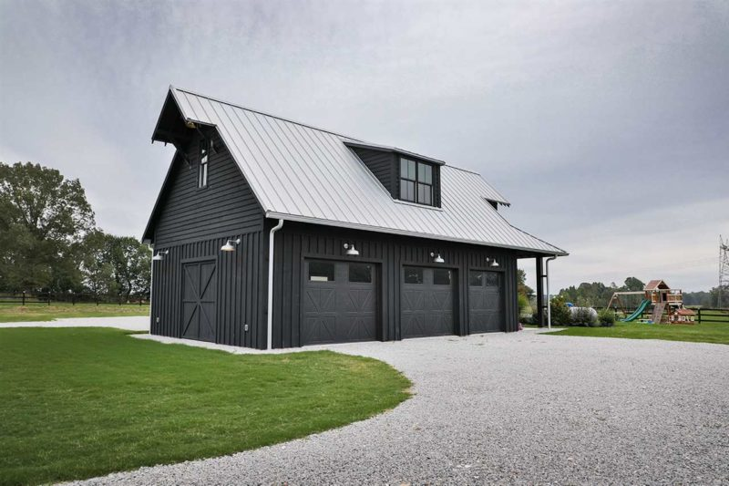 The barn is a three car garage that was designed so not to spoil the look of the property
