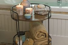 12 a rustic rolling cart of blackened steel and wooden tiers is a stylish idea for a rustic or vintage space
