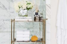 14 a refined gold and glass rolling cart is a gorgeous option for a sophisticated and chic bathroom