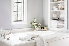 18 built-in shelves over the bathtub are a nice solution for storing a lot of things without wasting floor space