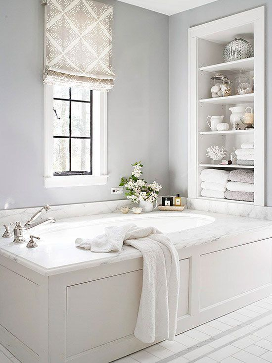 built in shelves over the bathtub are a nice solution for storing a lot of things without wasting floor space
