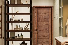 26 a comfortable stained wood shelving unit that divides this bathroom into zones is a very practical thing