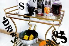 a halloween drink station with a letter garland