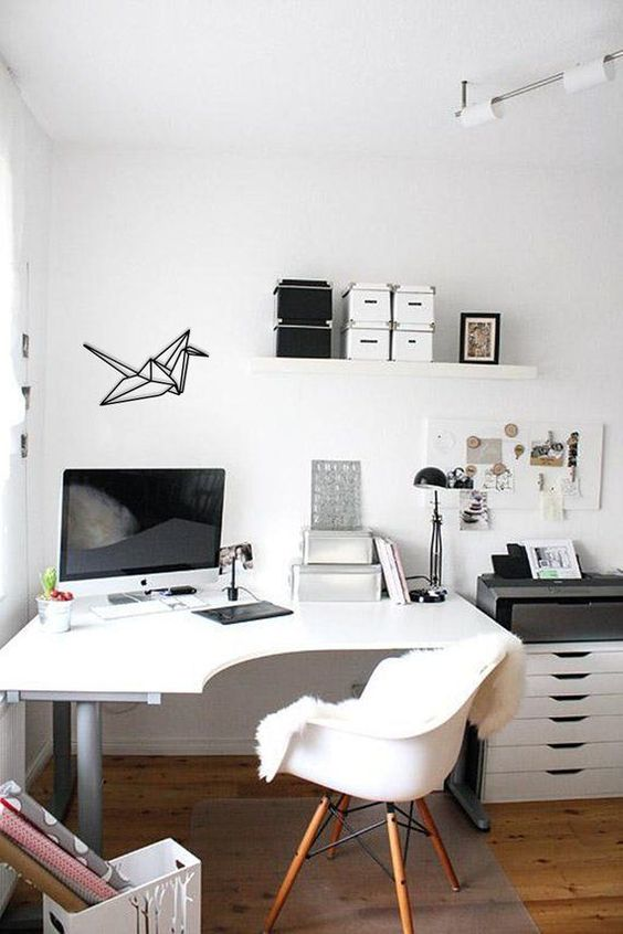 a curved corner desk in this home office gives more space without taking much floor space at the same time