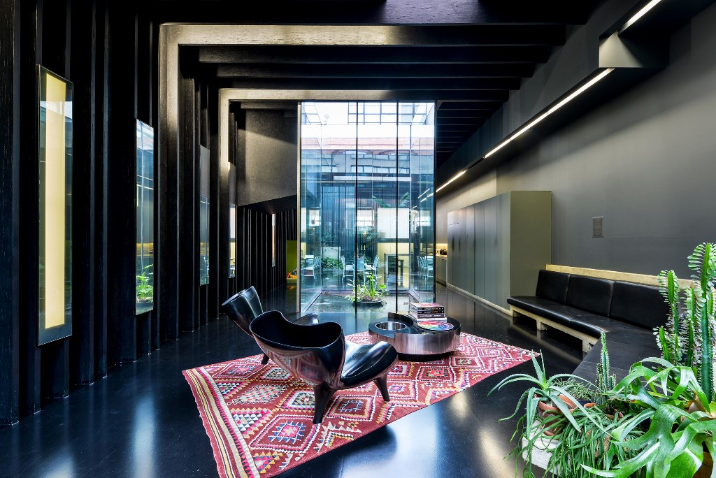 This bold contemporary house is called Lost House and features black interiors with much chic