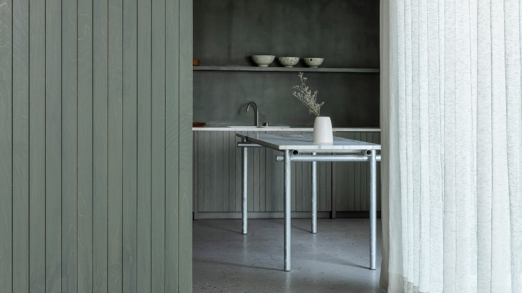 The decor is minimalist, with sleek lines and plain surfaces