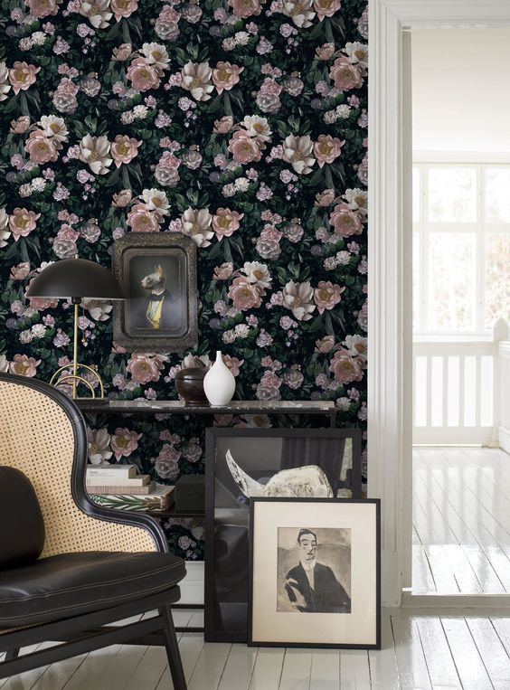 a dark floral realistic accent wall and dark refined furniture for a chic and charming space with a vintage feel