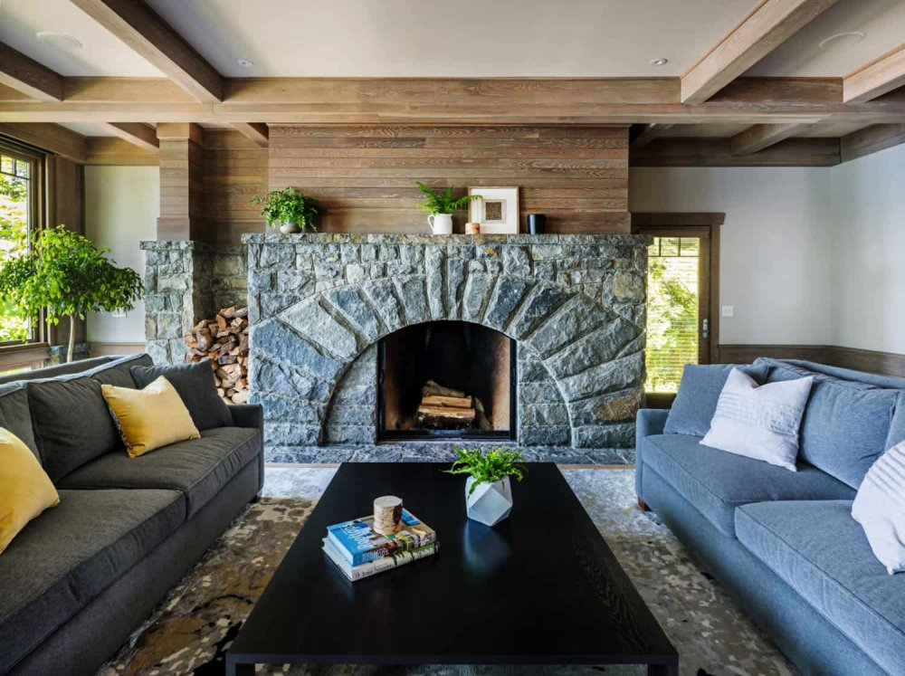 a cozy stone fireplace makes a statement in this living room