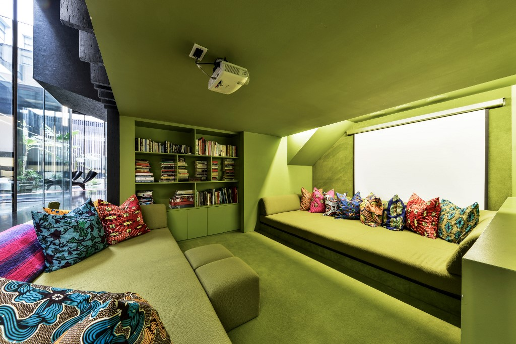 There's a projector and built in bookshelves in the conversation pit