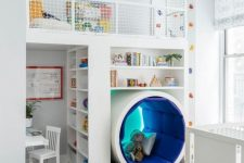 04 a unique kids' room with a study space, a reading sphere, an upper sleeping space and a climbing wall