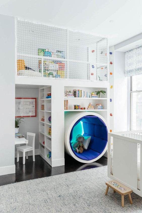 a unique kids' room with a study space, a reading sphere, an upper sleeping space and a climbing wall
