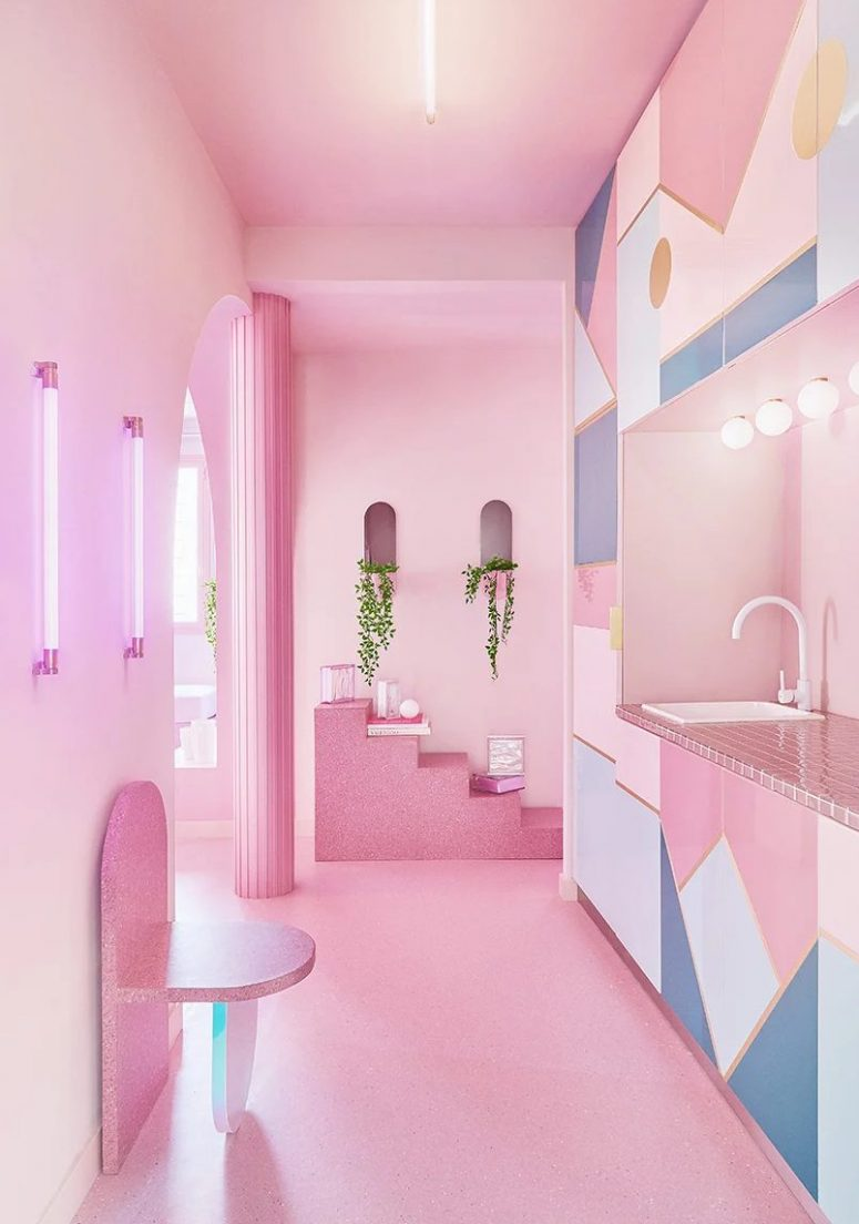 The kitchen is done with white, blue and pink, with pink tiles, catchy geometric prints and some stone furniture that rocks