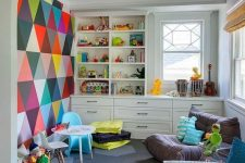 05 an ultimate playroom with a colorful statement wall, a neutral storage unit, some comfy chairs is very cool