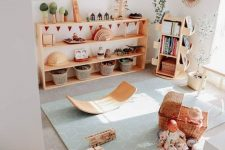 06 a cute and welcoming kids' play space with natural wooden furniture, pretty toys and potted plants and botanical posters