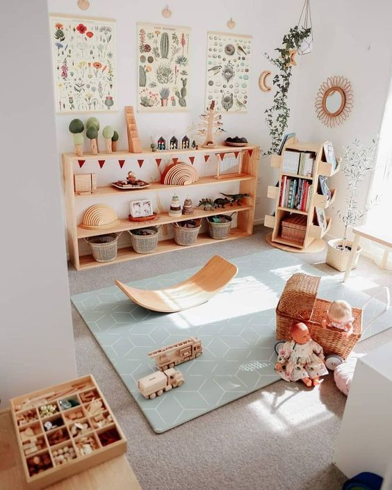 a cute and welcoming kids' play space with natural wooden furniture, pretty toys and potted plants and botanical posters