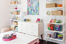 07 a colorful and bold playroom with open storage units, a bold artwork and bright rug, furniture and accessories