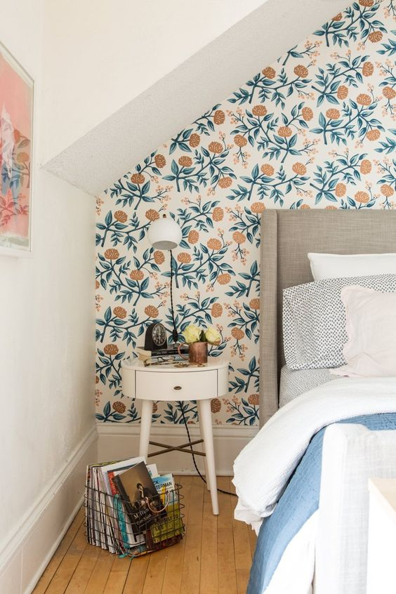 lovely modern floral wallpaper to highlight the headboard wall in a neutral and pastel bedroom