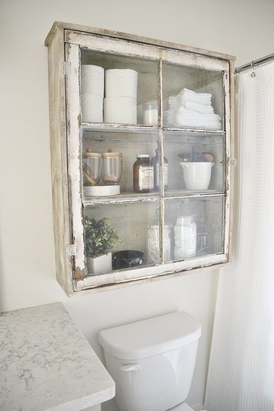 a shabby chic cabinet is a nice addition to a bathroom's decor