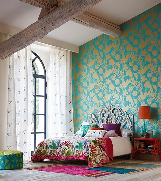 super bright turquoise and gold paetterned wallpaper for accenting a bold boho bedroom