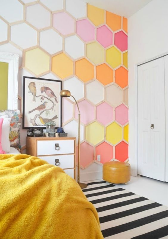 a bold bedroom done with a colorful honeycomb accent wall is a bright and cool idea to rock, it will add both color and pattern