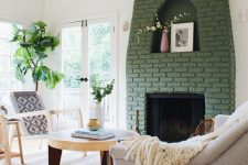 09 a fireplace with a green brick surround brings color to this neutral space and makes it catchier and more interesting