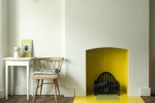 10 a minimalist fireplace with yellow tiles inside and out brings a warm feeling to the space and adds a bright splash of color