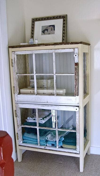 a shabby chic glass cabinet with old window frames instead of doors is a cool idea for a vintage bathroom