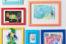 12 a colorful gallery wall with kids' artworks placed into colorful frames is a bold decor idea to rock