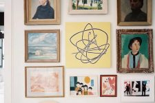 13 a gallery wall where usual and bold artworks are paired with kids' works and look super cool together