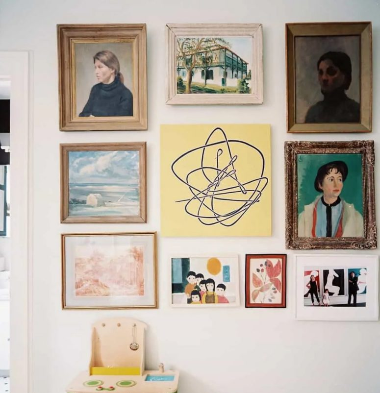 a gallery wall where usual and bold artworks are paired with kids' works and look super cool together