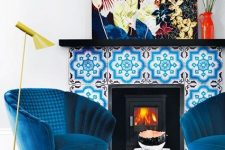 13 electric blue chairs, a bright blue printed rug, a bold blue tile fireplace and a colorful artwork create color galore that will raise your mood