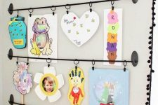 14 a bold kids' artwork display with railings is a stylish and cool idea and you may add more and more works there