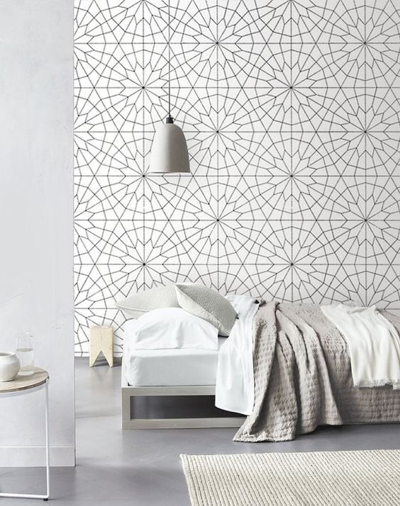 geometric flower wallpaper adds dimension to this bedroom and makes the neutral space look bold and very cool
