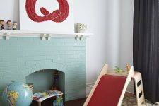 15 a non-working mint blue brick fireplace finishes off the playroom making it cozier and more welcoming