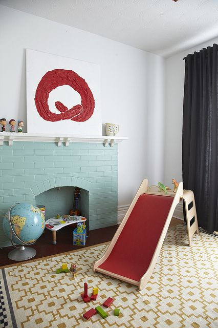 a non-working mint blue brick fireplace finishes off the playroom making it cozier and more welcoming