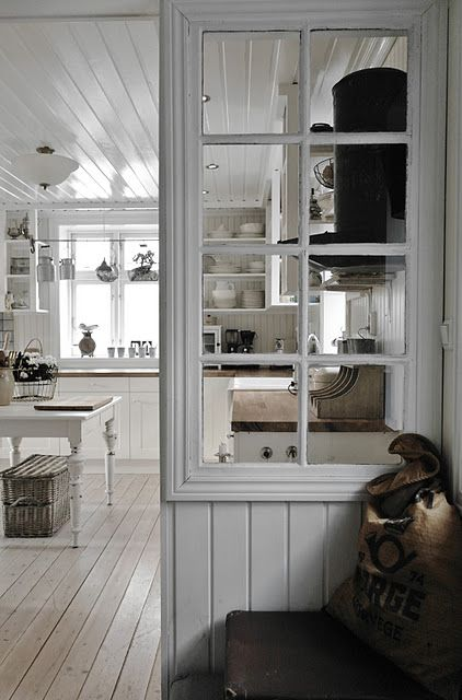 a space divider made of some wood and an old window frame is a stylish idea to go for