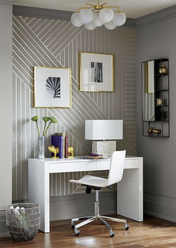 linear wallpaper accentuates this home tiny modern and very refined home office nook and makes it more chic