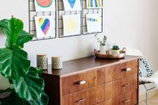 15 several grids attached to the wall with bold artworks of your kids is a cool idea that will allow to add or remove some of art pieces