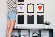 16 a kids' artwork gallery wall organized like that is a very creative and bold idea to go for
