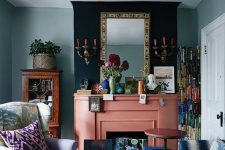 17 a bright whimsical living room with a slamon pink fireplace and colorful artworks looks unusual and very eye-catchy