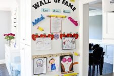 17 a wall of fame is a gorgeous way to make your kids feel proud of what they have created