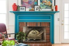 18 a bright mid-century modern living room with a bold blue mantel with white framing over a brick fireplace for ultimate elegance