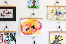 19 a bold gallery wall with lots of kids' artworks hanging is a creative and chic idea to try