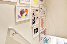 20 a stylish gallery wall over the staircase will display your kids' works at their best and they will be seen any time