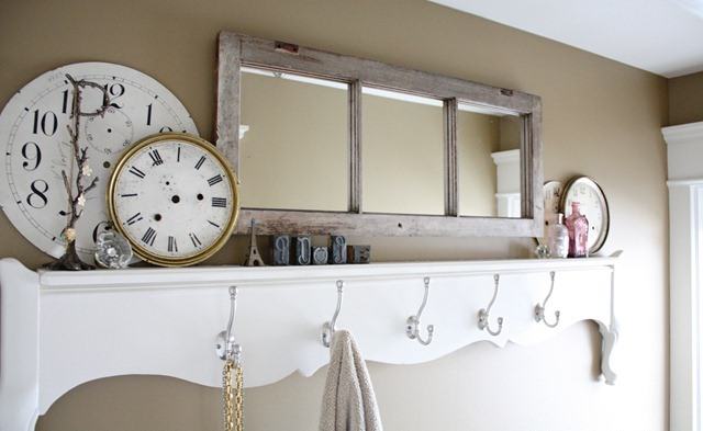 an old window frame repurposed into a stylish mirror to hang it in a mudroom or an entryway