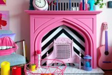 21 a quirky colorful living room finished off with a hot pink faux fireplace with colorful accessories on the mantel