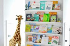 22 a comfy space for reading – ledges with colorful kid books and a soft seat with toys
